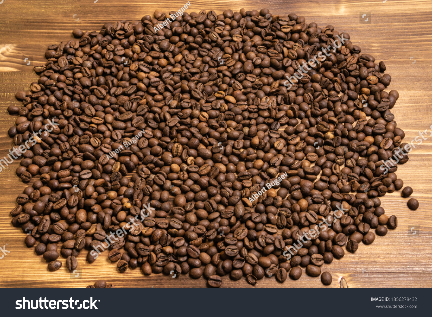 Roasted coffee beans in bulk on a wooden background #1356278432