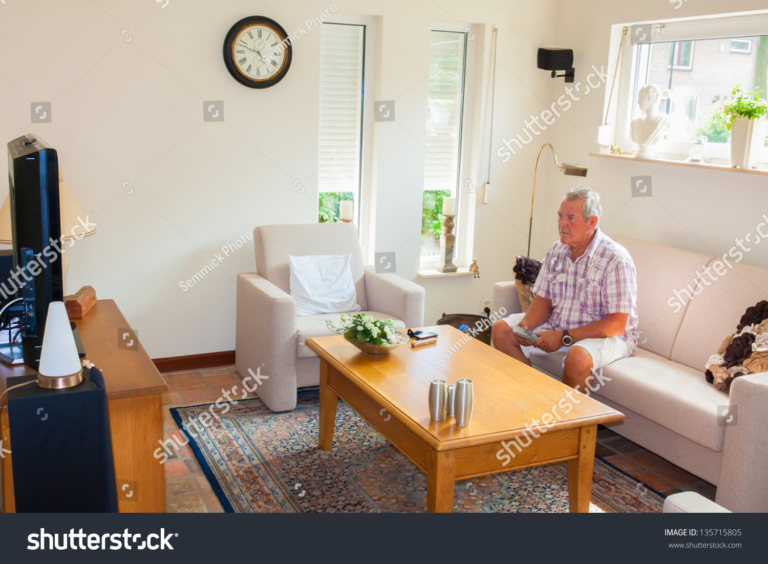 Man Living Room Senior Man Watching Tv In Modern Bright Living Room Stock Photo