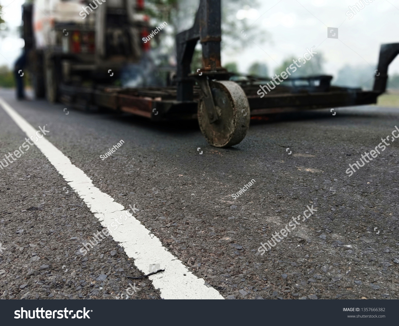 Road Construction By Burning Asphalt Road Stock Photo (Edit