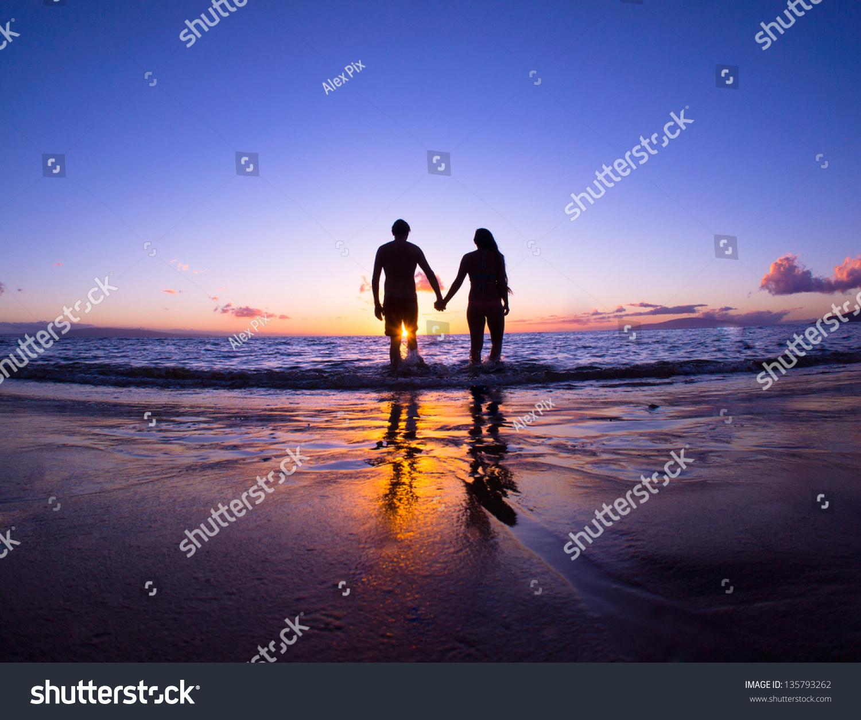 Romantic Couple Enjoying Beach Walk Sunset Stock Photo