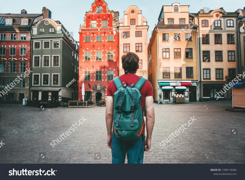 Man tourist walking in Stockholm travel sightseeing Gamla Stan Stortorget architecture lifestyle summer trip vacations in Sweden  #1358118482
