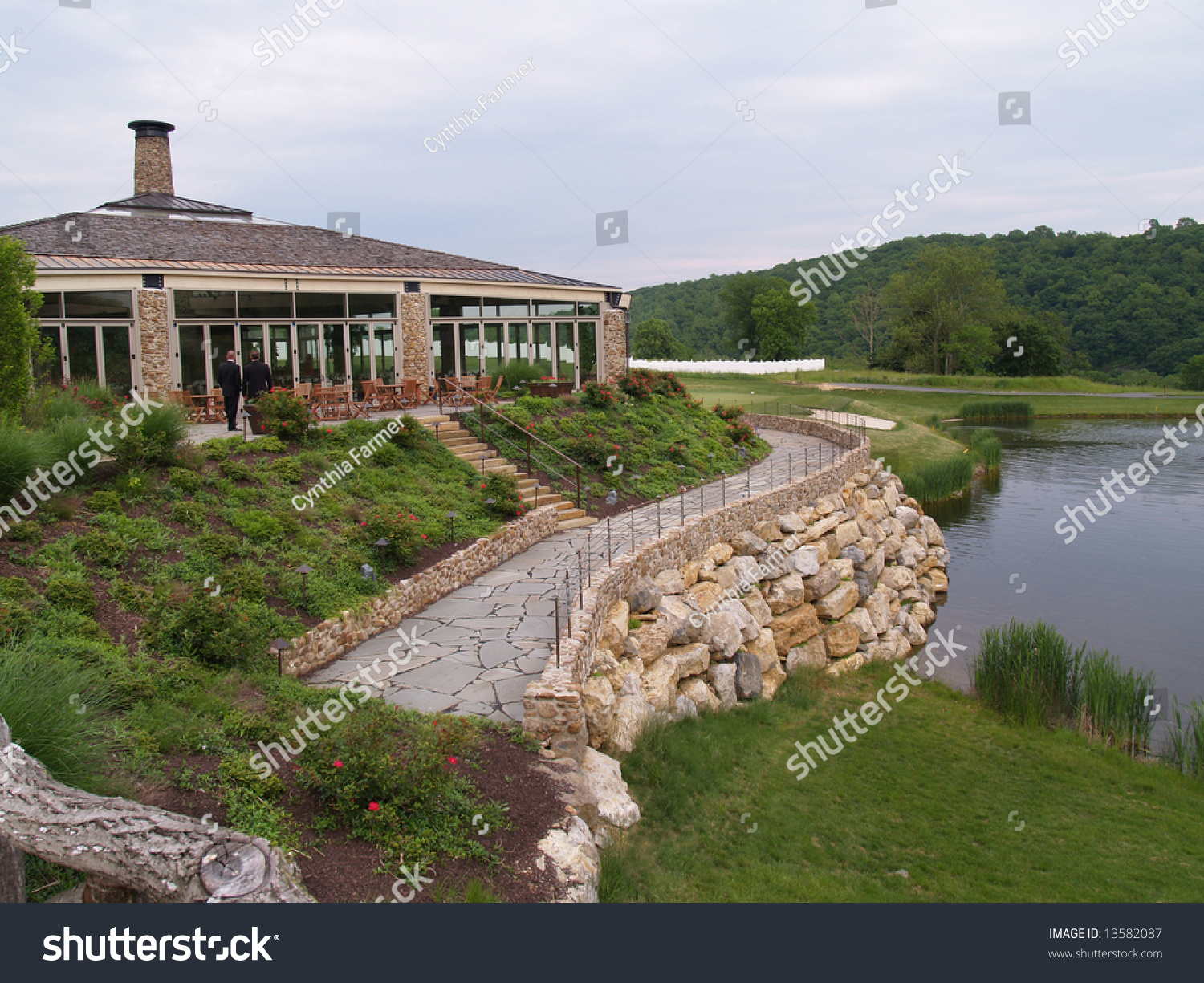 Exterior Of A Modern Building By A Golf Course And Calm Water Stock Photo 13582087 Shutterstock