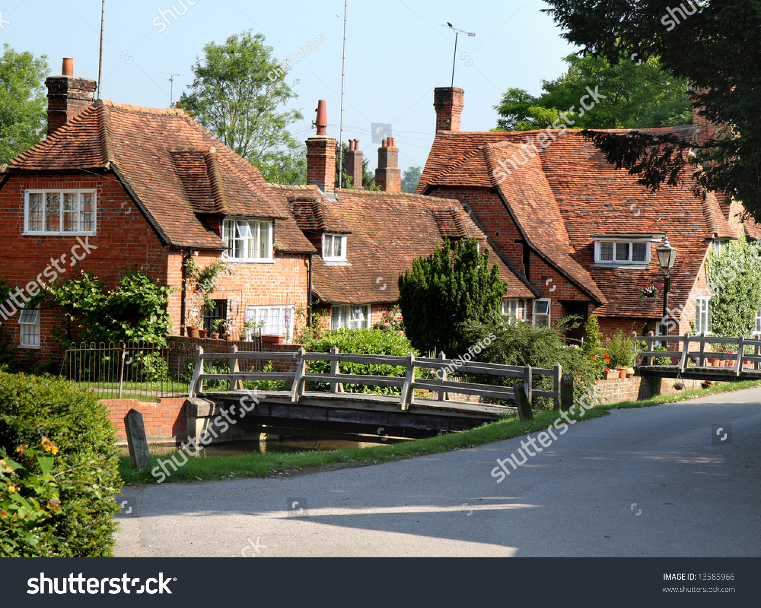 Traditional English Village Houses With Stream And Footbridge In Front
