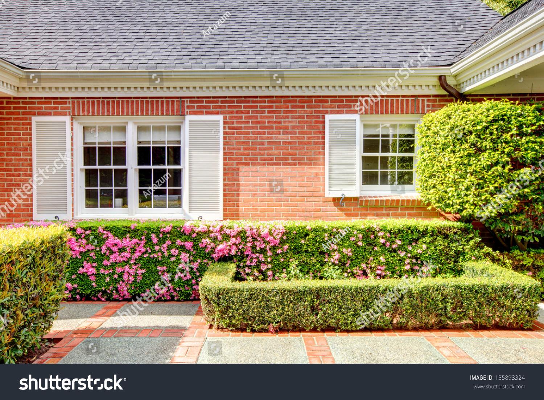 Brick red house english garden white stock photo 135893324 for Red brick garden