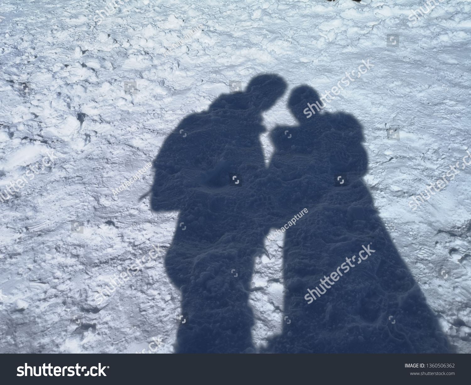 Couple shadow in snow under winter times. Secret Lovers, Lover Journeys. #1360506362