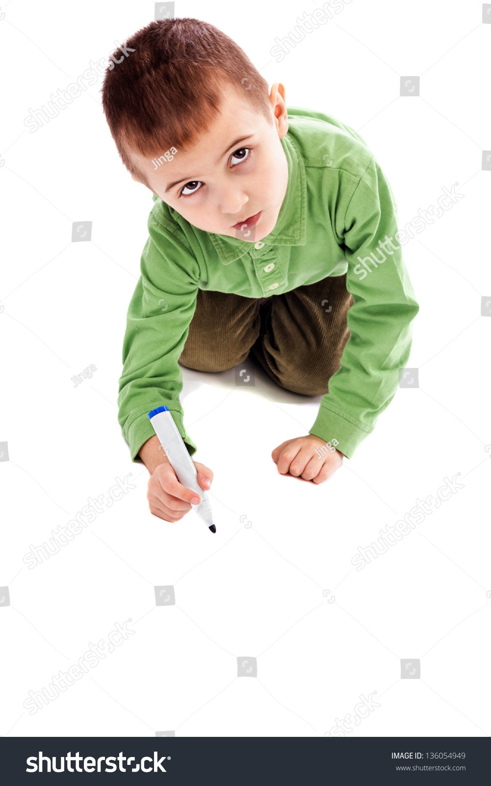 cute little boy drawingwriting marker on stock photo