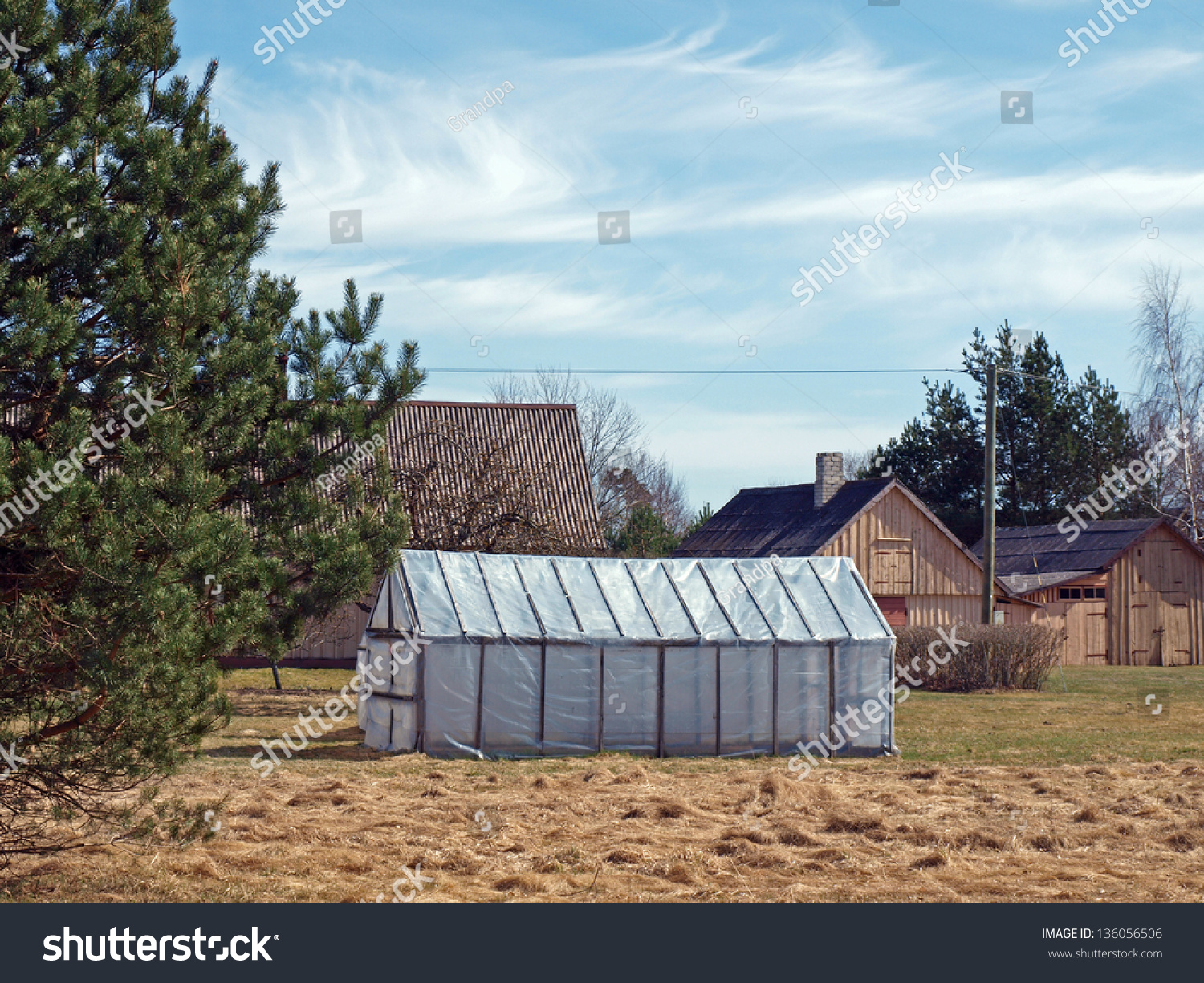 Simple homemade plastic greenhouse on small country farm for Country farm simples