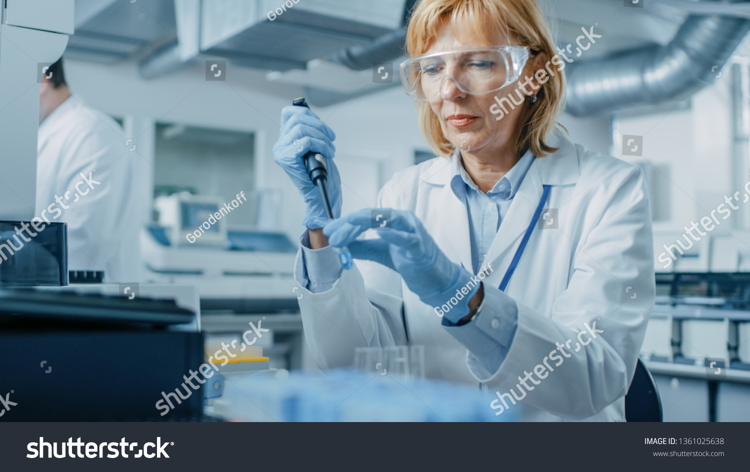Female Research Scientist Uses Micro Pipette while Working with Test Tubes. People in Innovative Pharmaceutical Laboratory with Modern Medical Equipment for Genetics Research. #1361025638