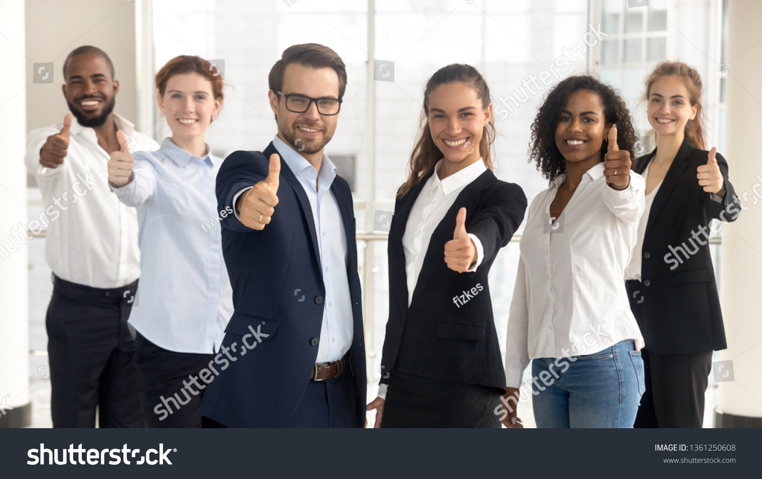 Business leaders with employees group showing thumbs up looking at camera, happy professional multicultural office team people recommend best corporate service, proud or good career, human resource #1361250608