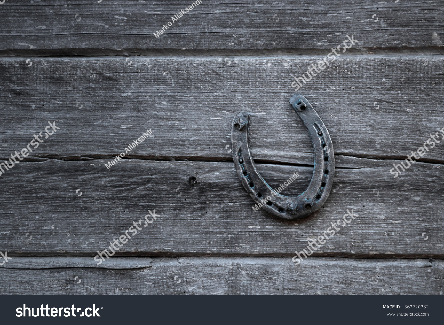 Old horseshoe on an old wooden board. The concept of luck, luck, luck. #1362220232