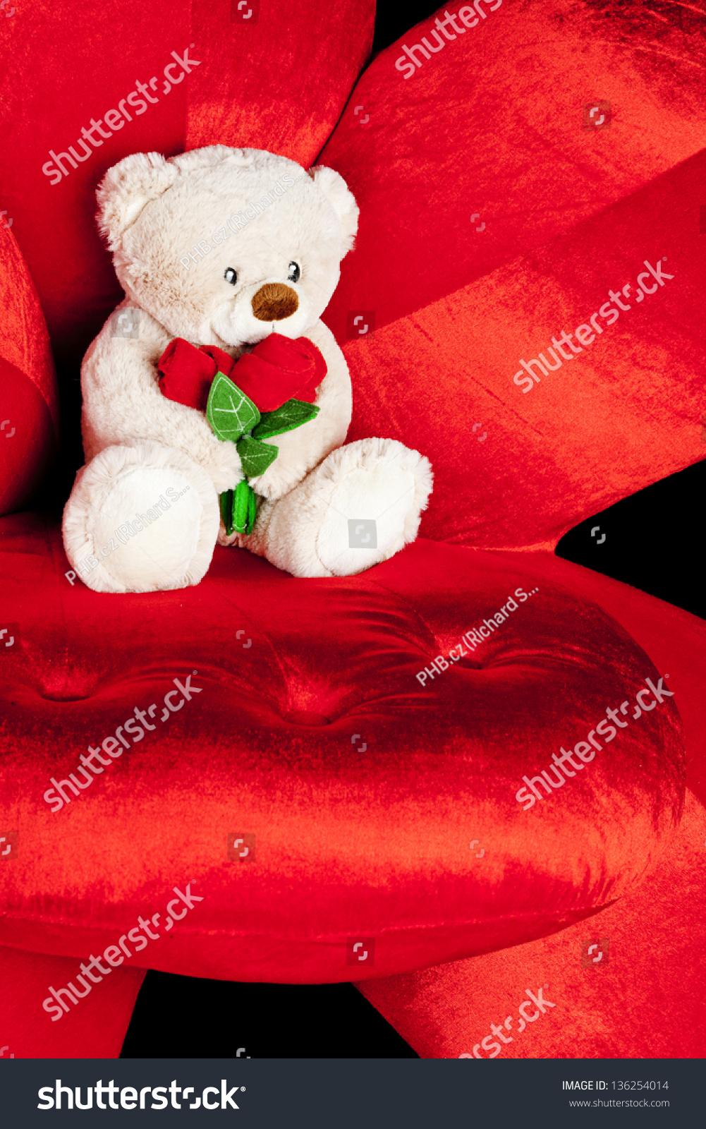 teddy bear on red armchair stock photo 136254014