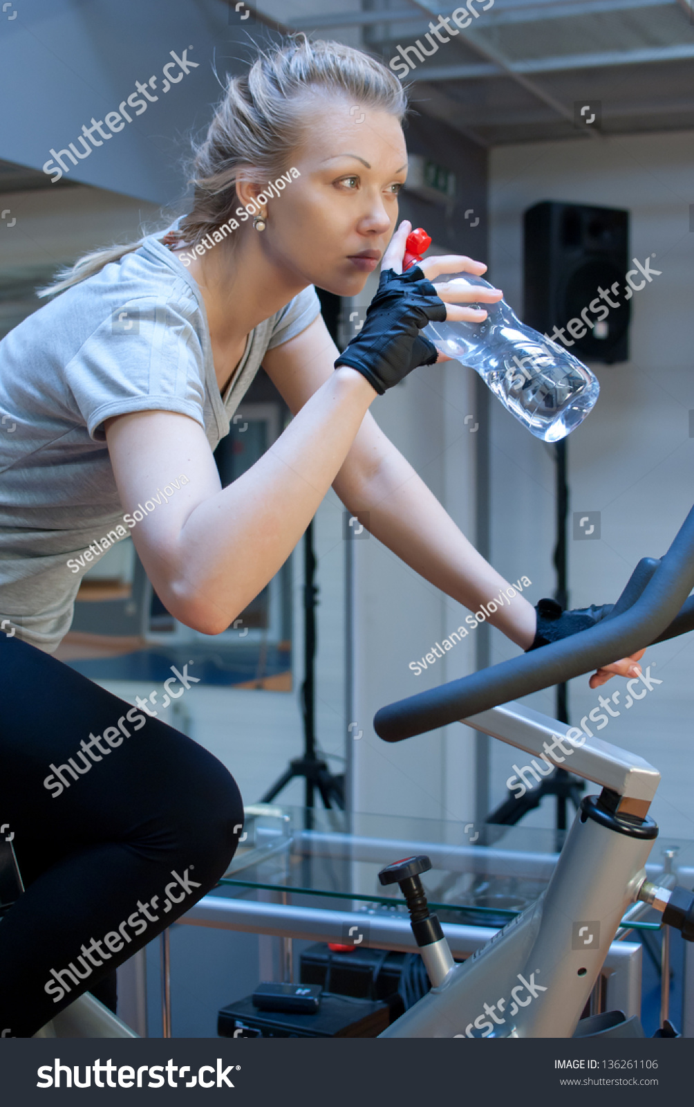 Woman drink water gym stock photo 136261106 shutterstock woman drink water in gym sciox Gallery