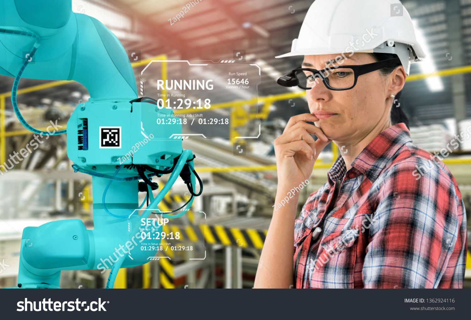 Virtual Augmented reality technology in industry 4.0. Engineer woman wearing AR glasses to see AR service,Thermal Monitoring motor for check destroy part of smart robot arm machine in smart factory. #1362924116