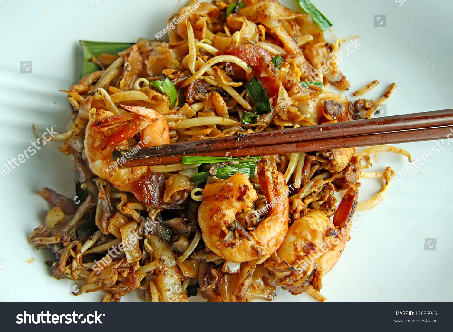 Fried flat rice noodles traditional chinese stock photo for Authentic malaysian cuisine
