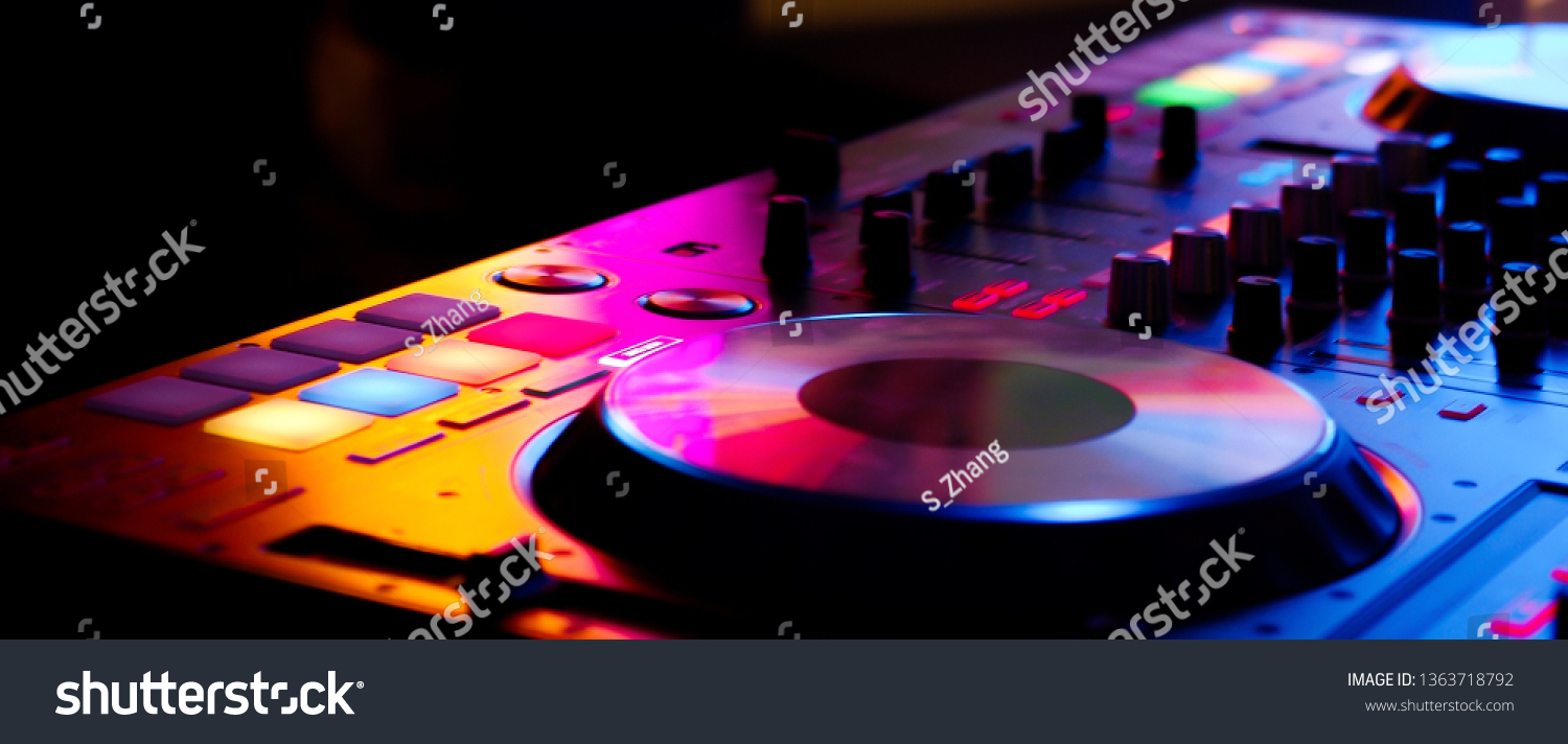 DJ controller close up view in live performance night club dance music #1363718792