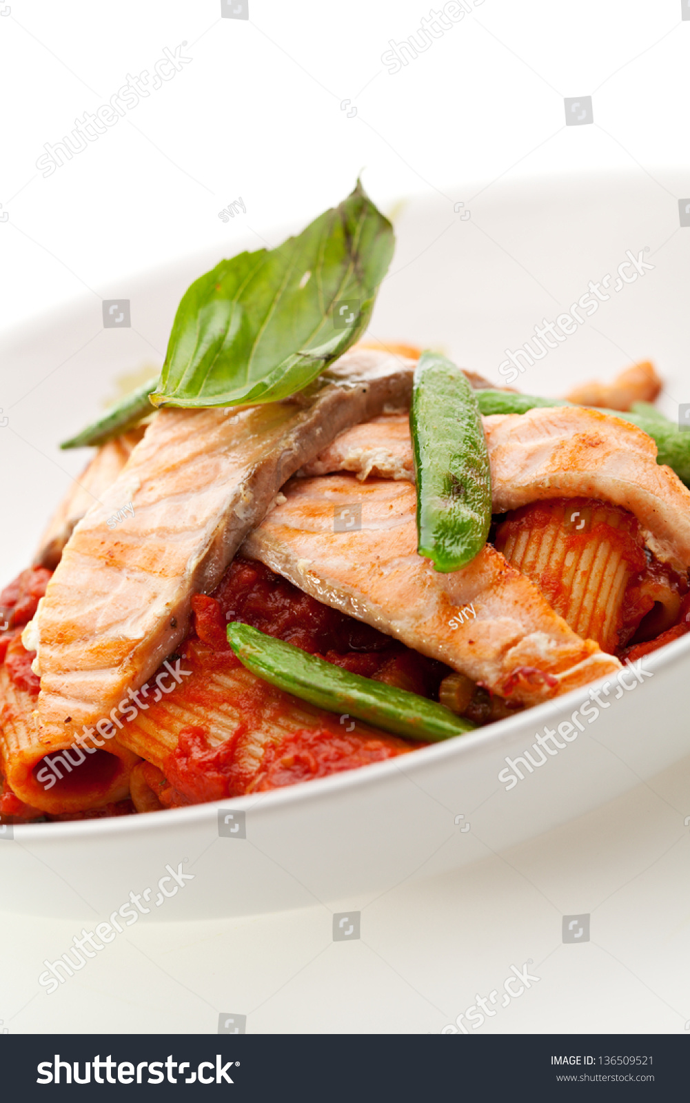 Pasta Penne With Fried Salmon. Garnished With Tomato Sauce Stock Photo ...