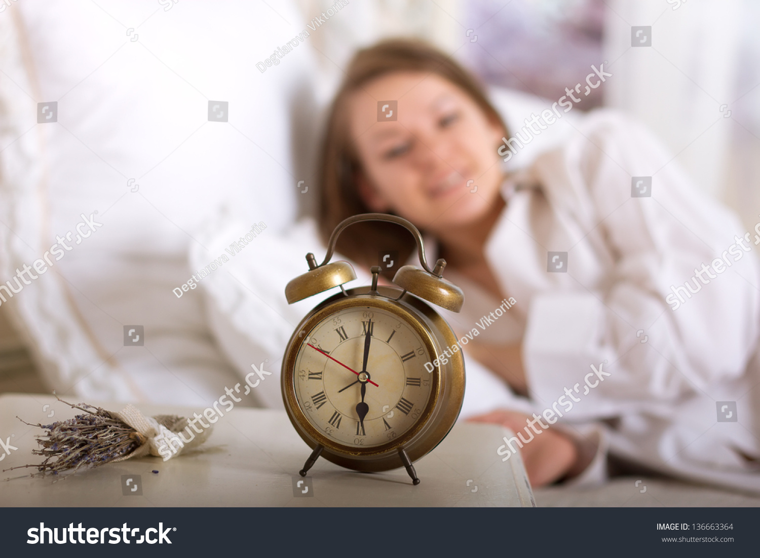 Alarm Clock On Table And Woman Sleeping In Background ...