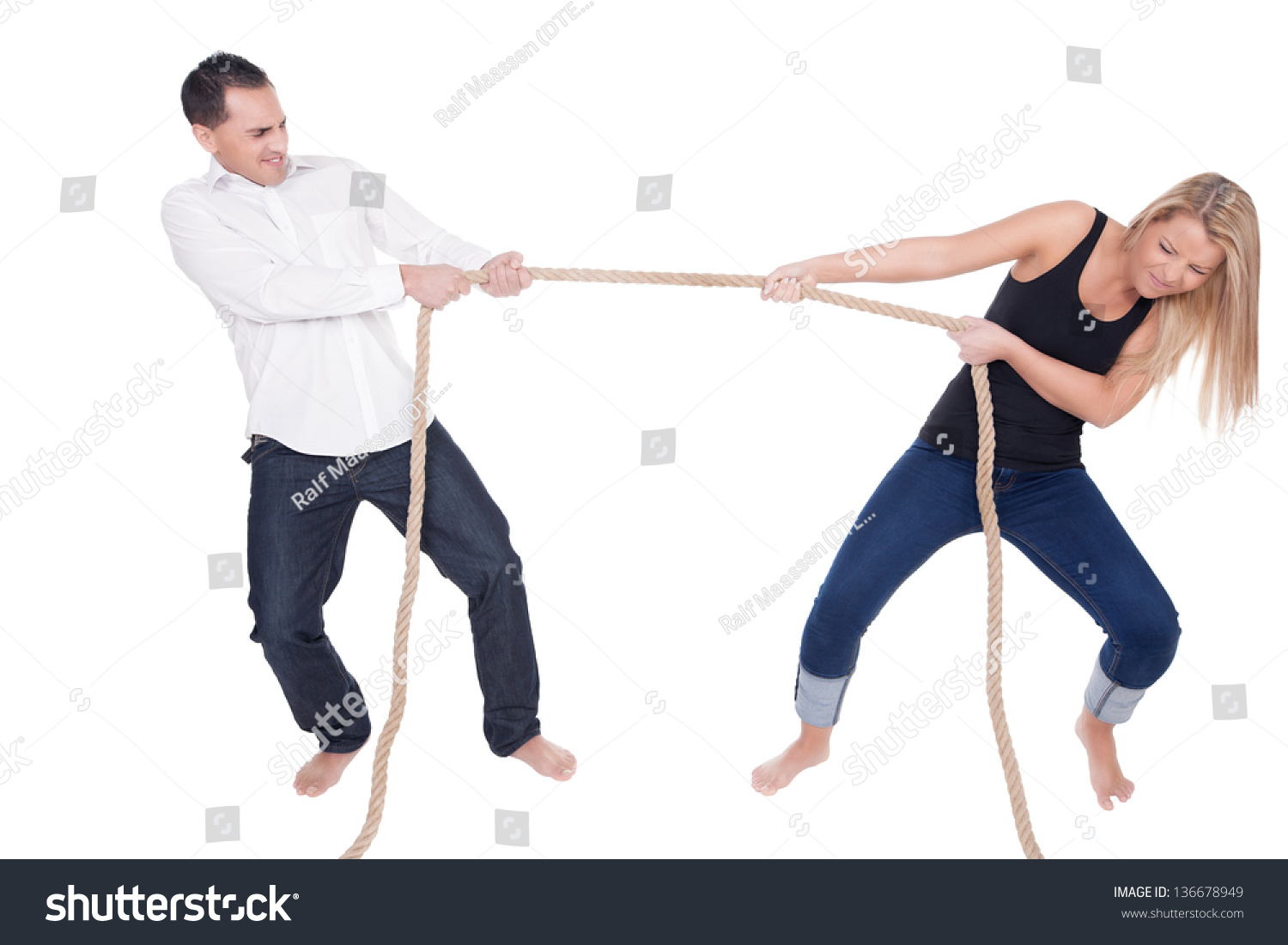 Grimace face clip art stock photo woman pulls a face in upset - Man And Woman Having A Tug Of War Each Leaning Back And Straining With The Effort