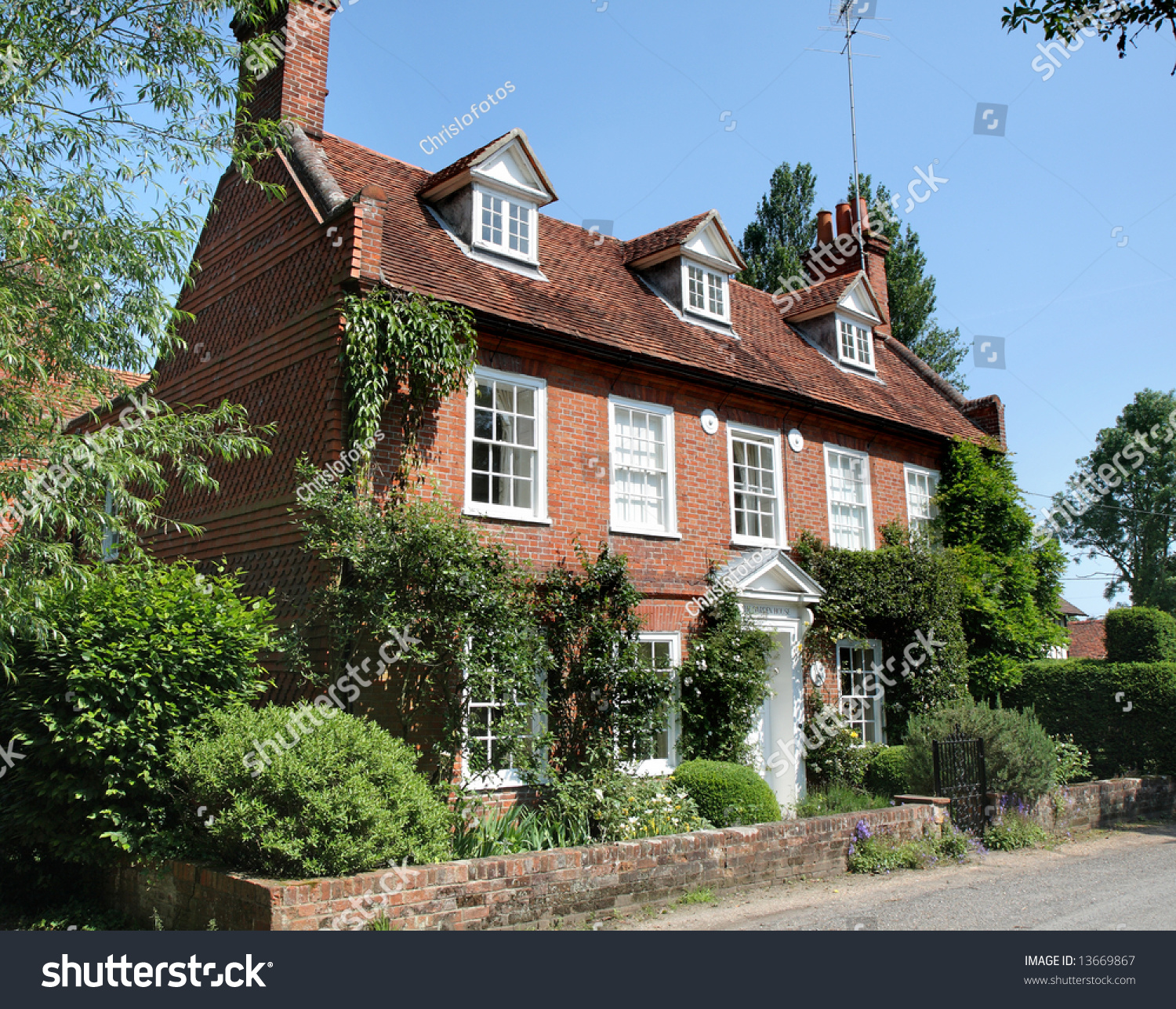 Traditional georgian style english village house with pantiled wall and garden stock photo - English style house plans tradition and functionality ...