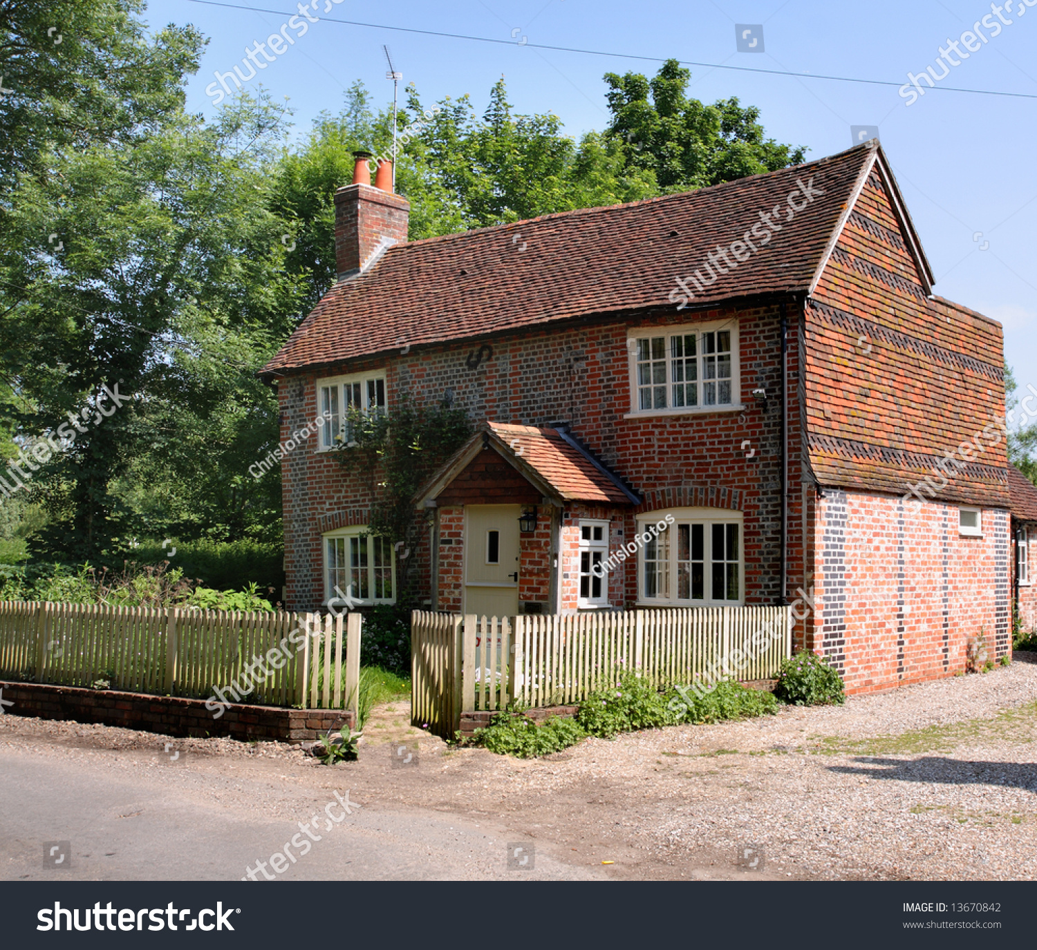 Quaint crooked red brick cottage in a rural english for Brick cabin