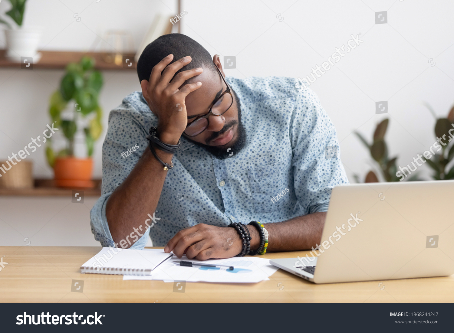 Tired depressed bored african businessman frustrated by business failure bankruptcy looking at laptop feel exhausted having headache, upset stressed black office worker worried about problem at work #1368244247