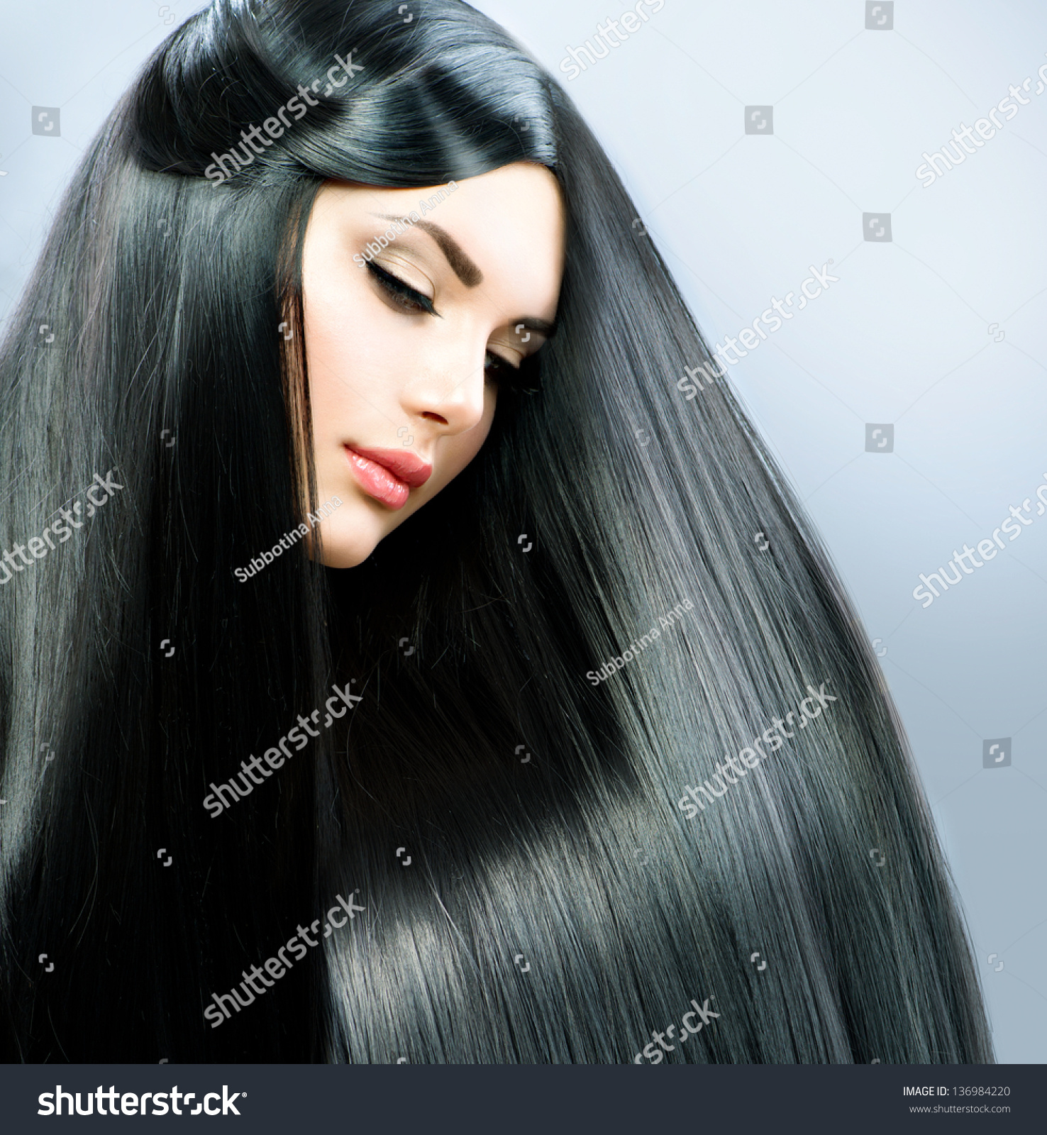 Beautiful girl with black hair consider