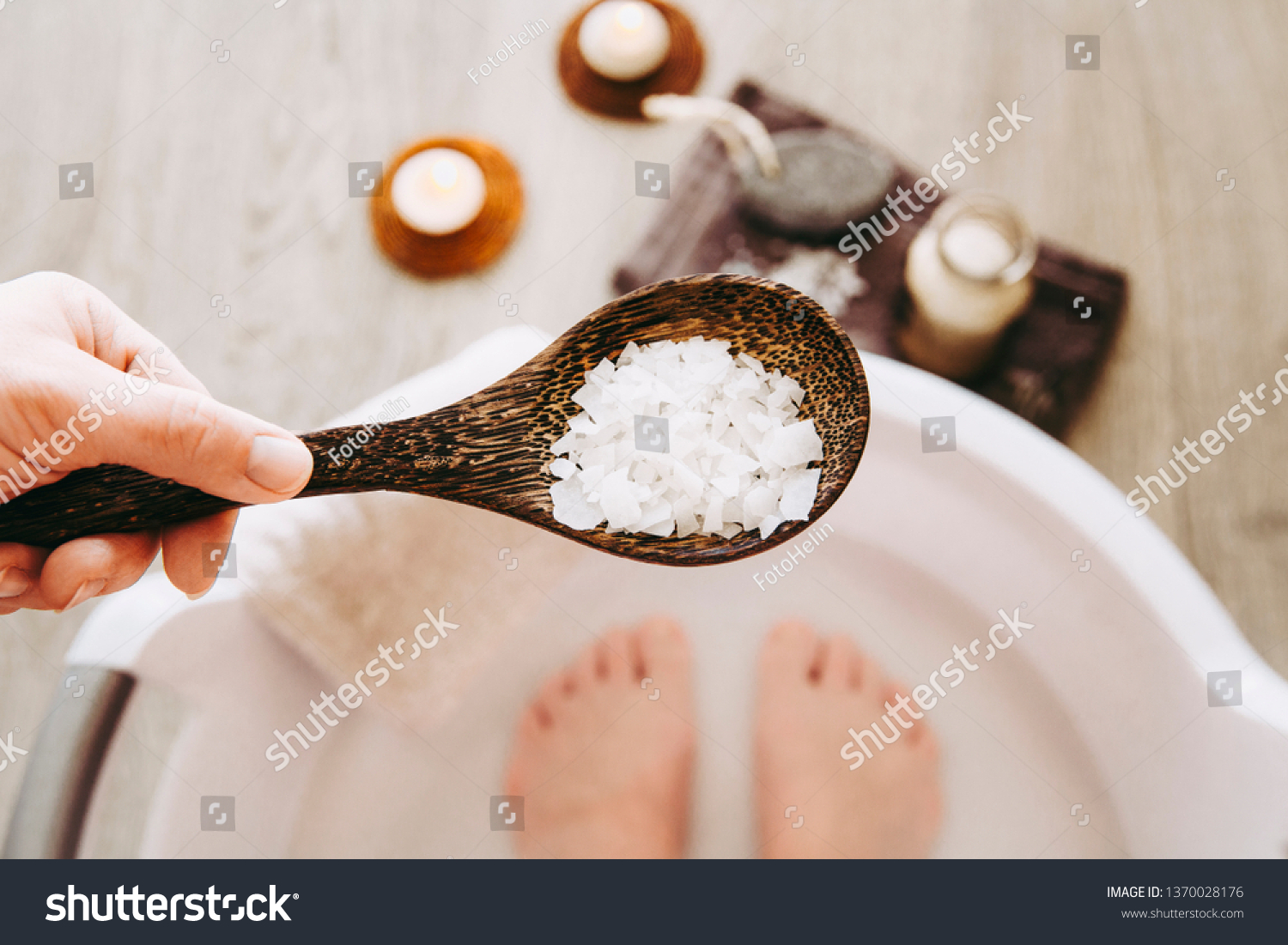 Adding Magnesium Chloride vitamin salt in foot bath water, solution. Magnesium grains in foot bath water are ideal for replenishing the body with this essential mineral, promoting overall well being. #1370028176