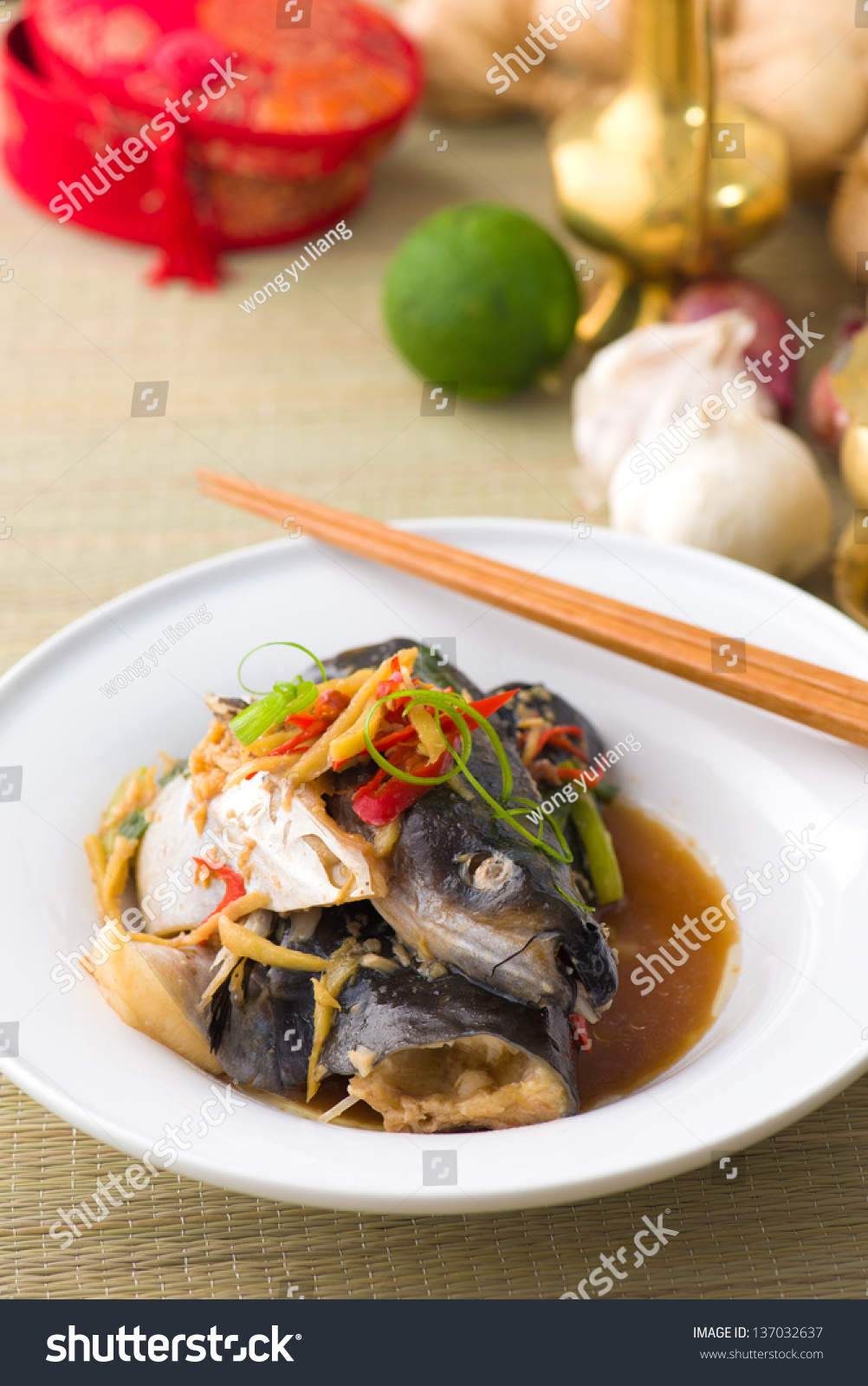Steam fish head soy sauce stock photo 137032637 shutterstock for Soy sauce fish