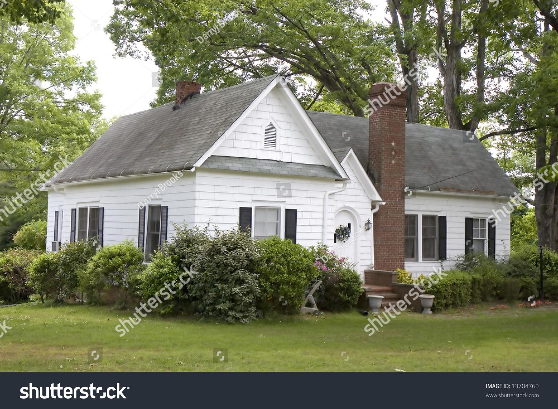 An old farmhouse with siding and a brick chimney stock for Farmhouse brick