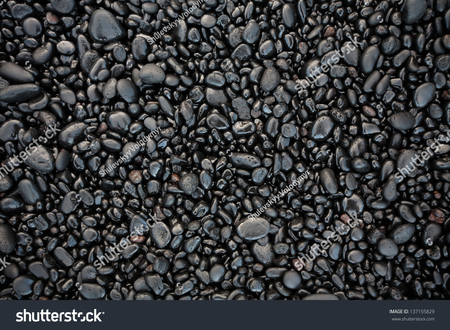 black stones on a black sand beach as a background hawaii maui usa stock photo 137155829. Black Bedroom Furniture Sets. Home Design Ideas