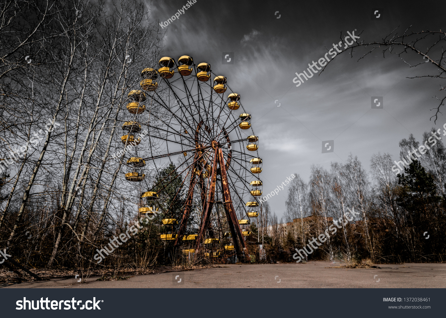 Old ferris wheel in the ghost town of Pripyat. Consequences of the accident at the Chernobil nuclear power plant #1372038461