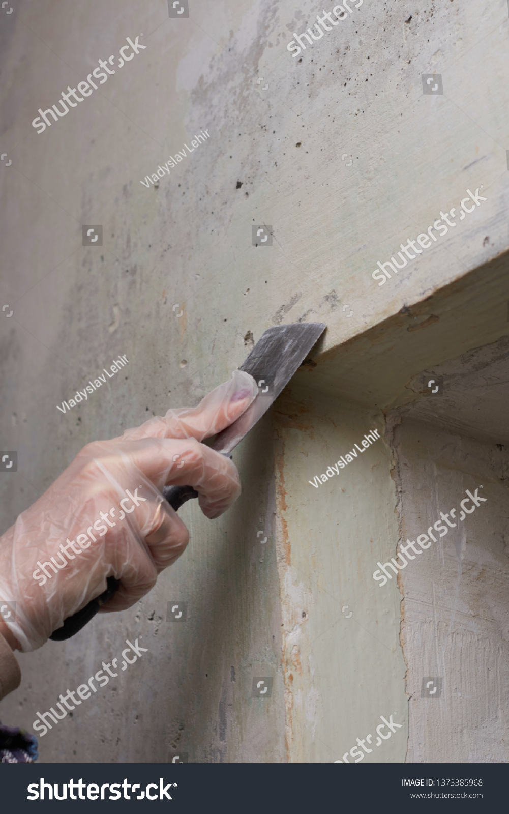 Woman plastering and smoothing wall. #1373385968