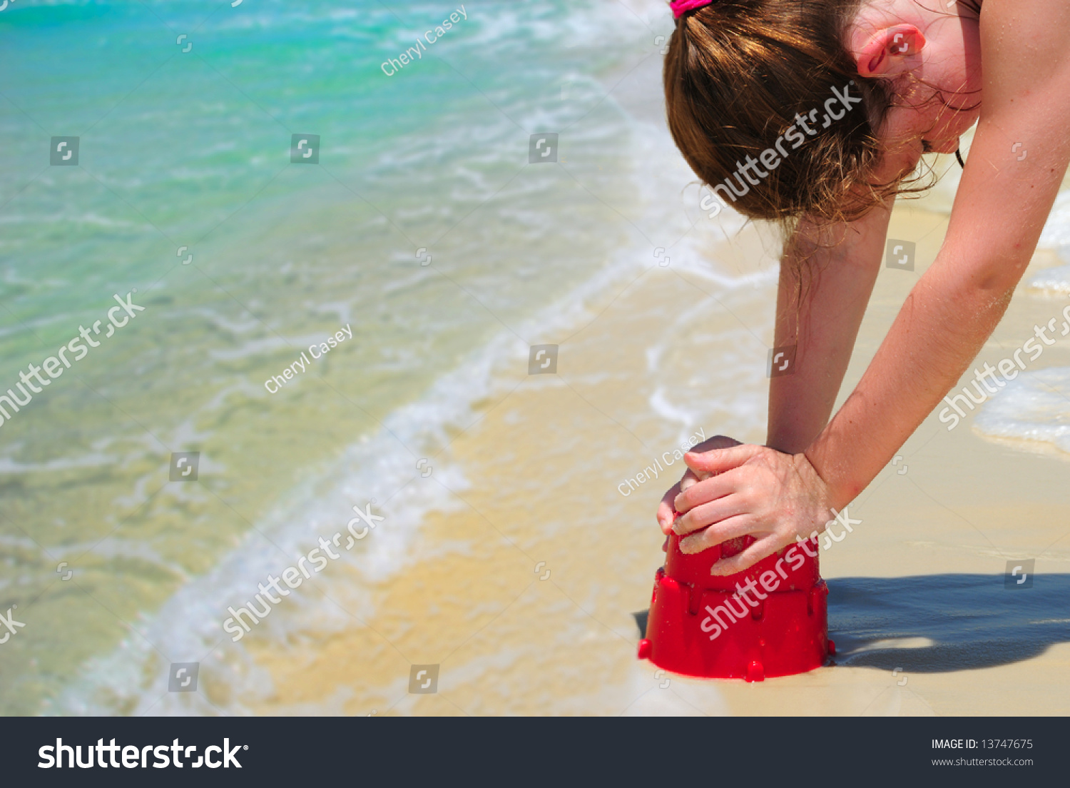 Girl Sitting On Sand Beach Side View High-Res Stock Photo