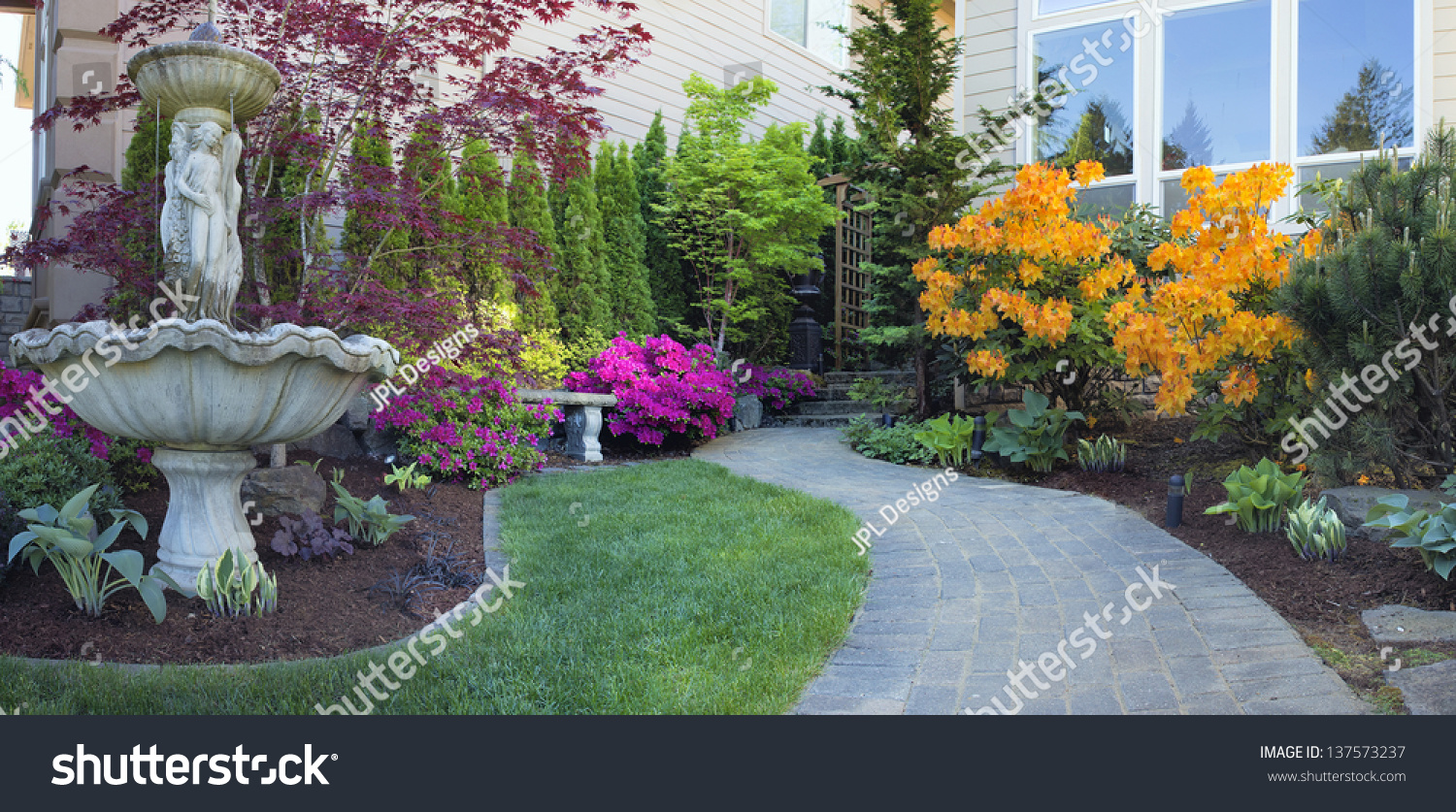 Frontyard Landscaping With Water Fountain And Brick Pavers Path With Azalea  Flowers In Bloom