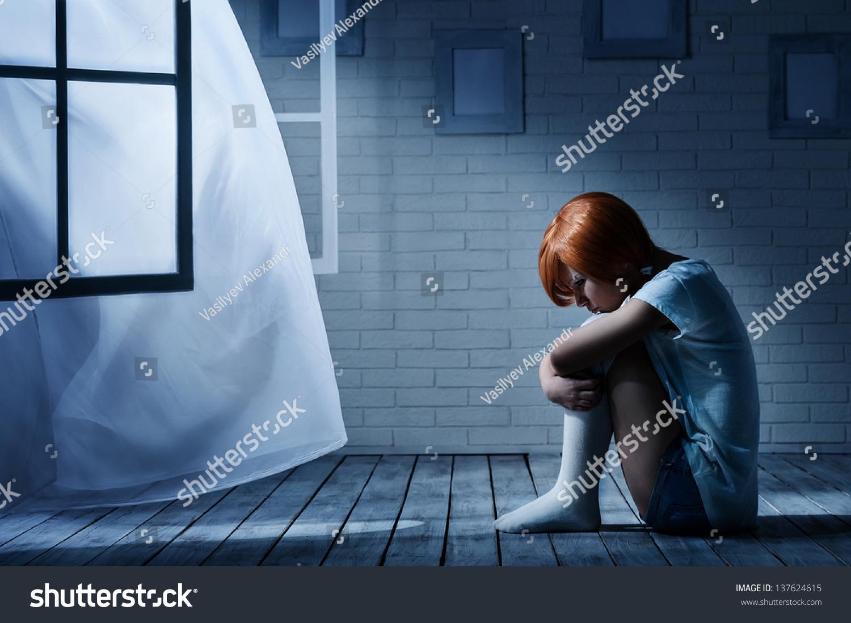 Dark empty room with window - Lonely Girl Sits In An Empty Dark Room Opposite The Window