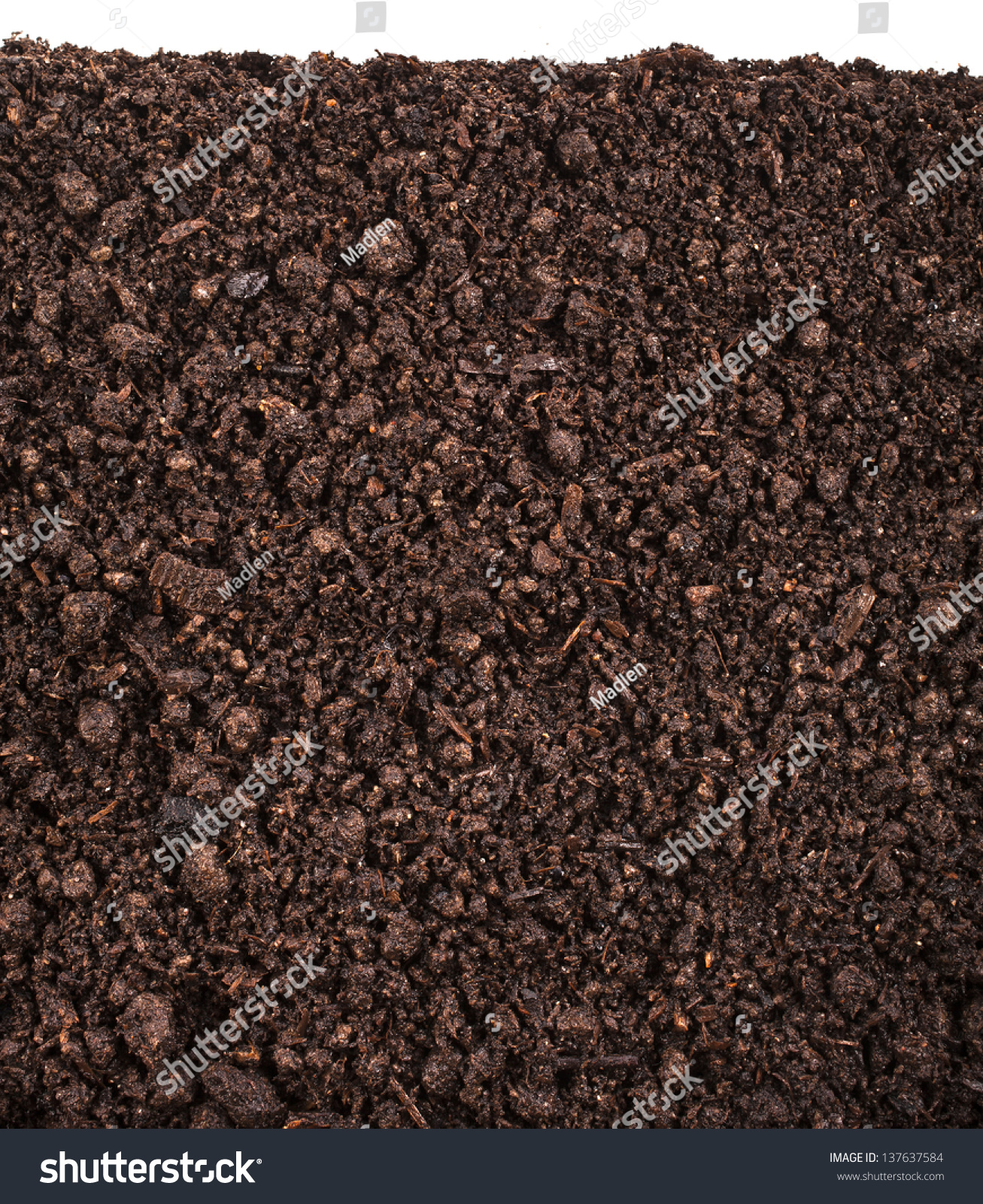 Close up of organic soil isolated on white background for Uses of soil in english