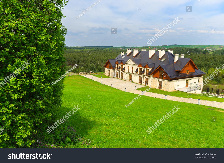 Traditional wood stone house building green lawn park bobolice castle poland stock photo - Traditional polish houses wood mastership ...