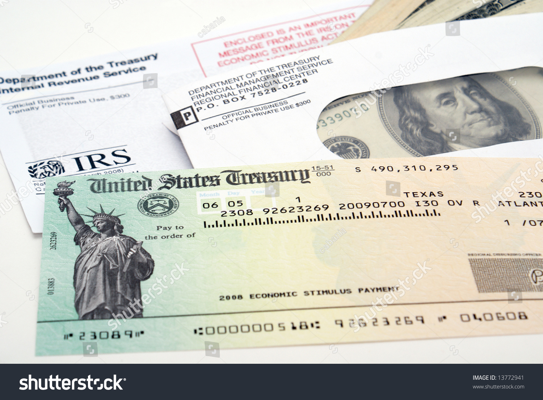 Stimulus economic tax return check usa stock photo 13772941 stimulus economic tax return check and usa currency falaconquin