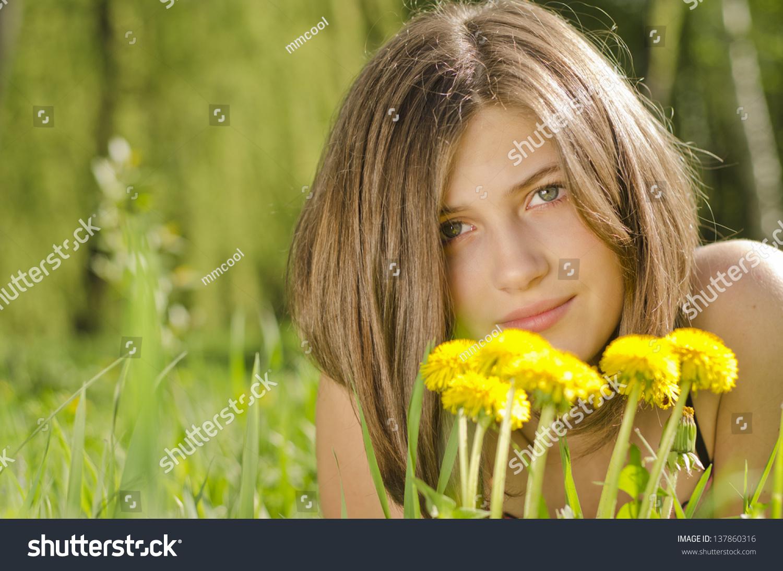 Pretty girl on the meadow smells flower of dandelion ez canvas izmirmasajfo