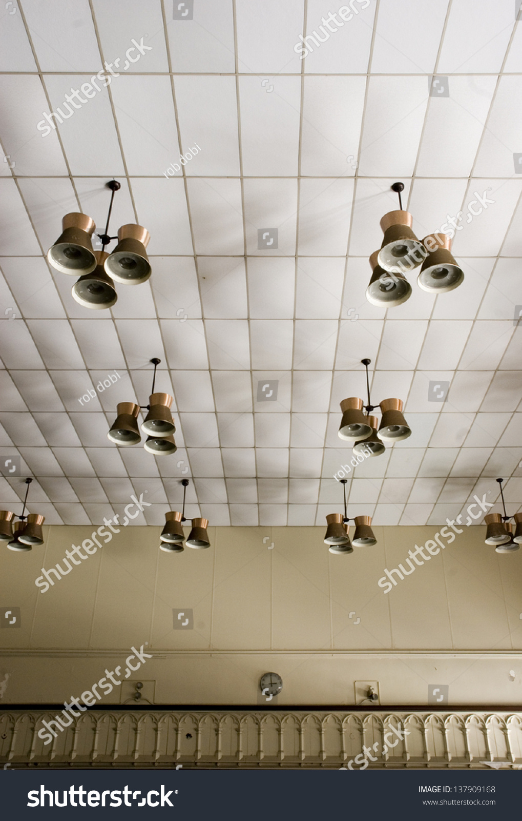 Ceiling with light fixtures inside an abandoned school