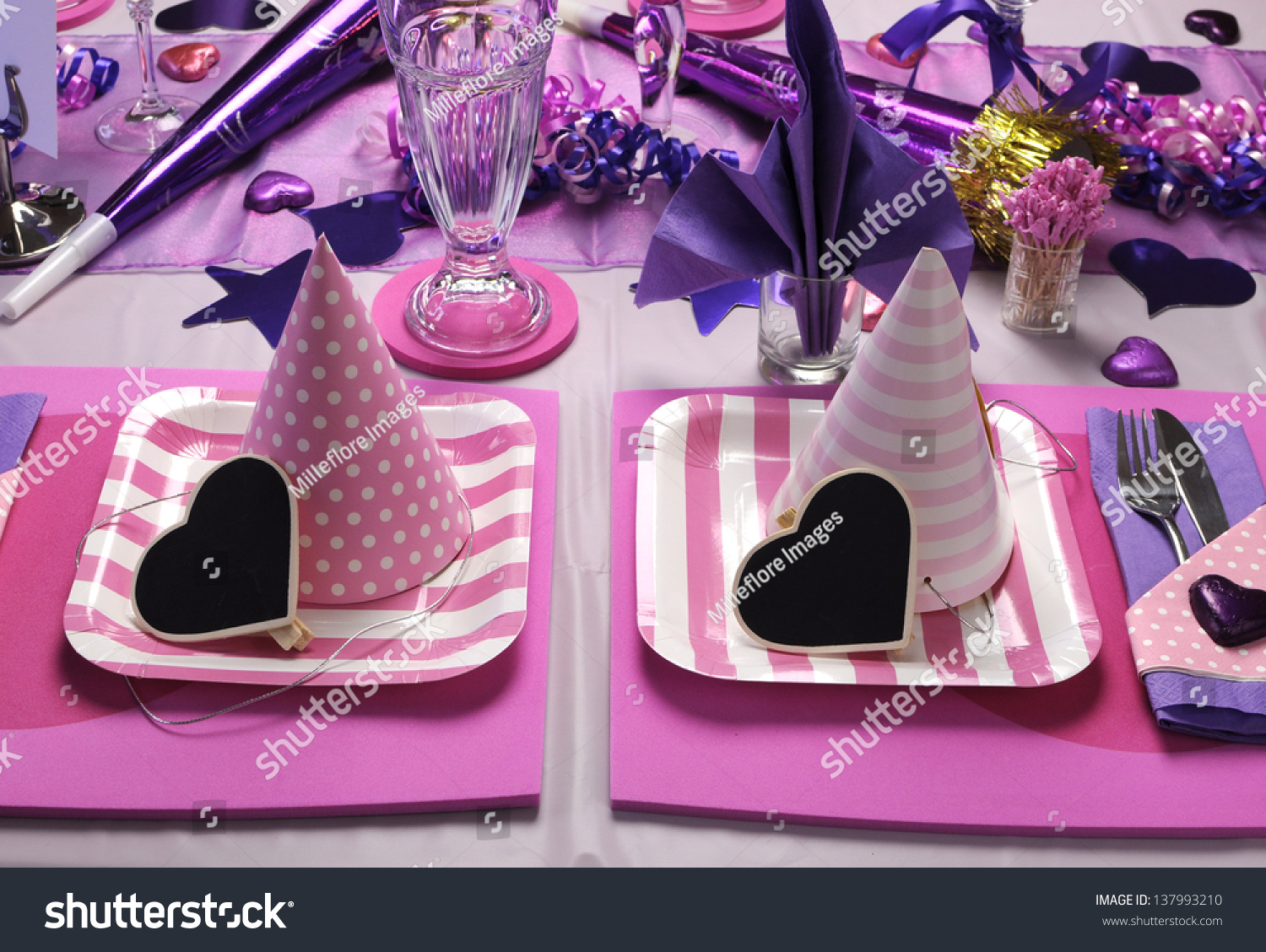 Pink and purple theme party table setting decorations for Dots and stripes party theme