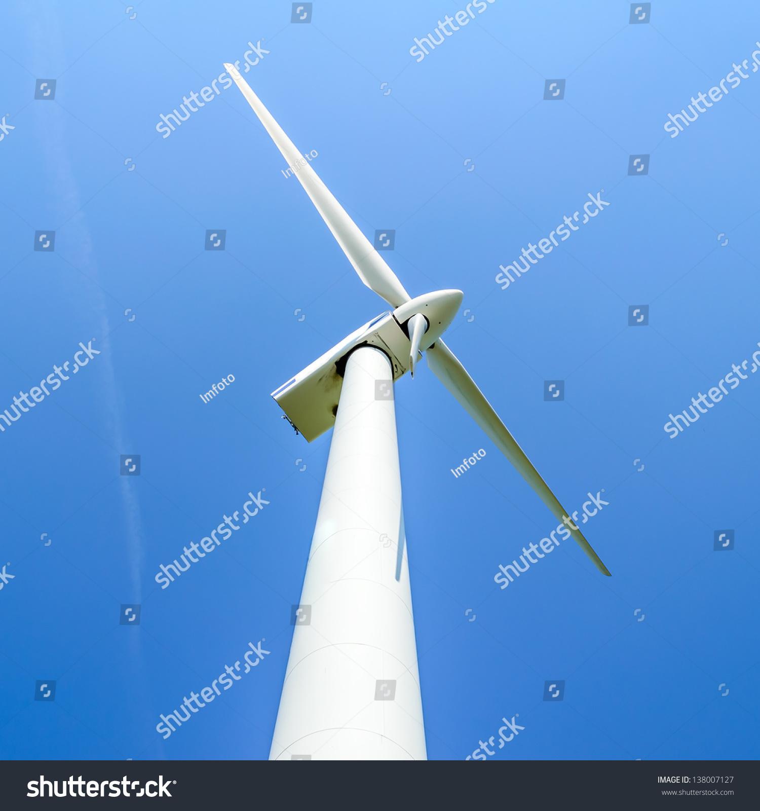 Wind Turbine Against Blue Sky Wind Stock