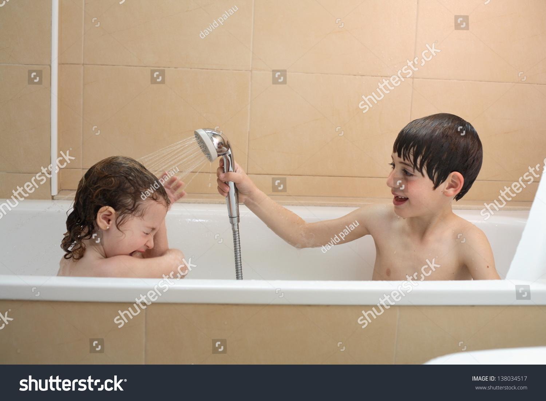 Brunette boy showering