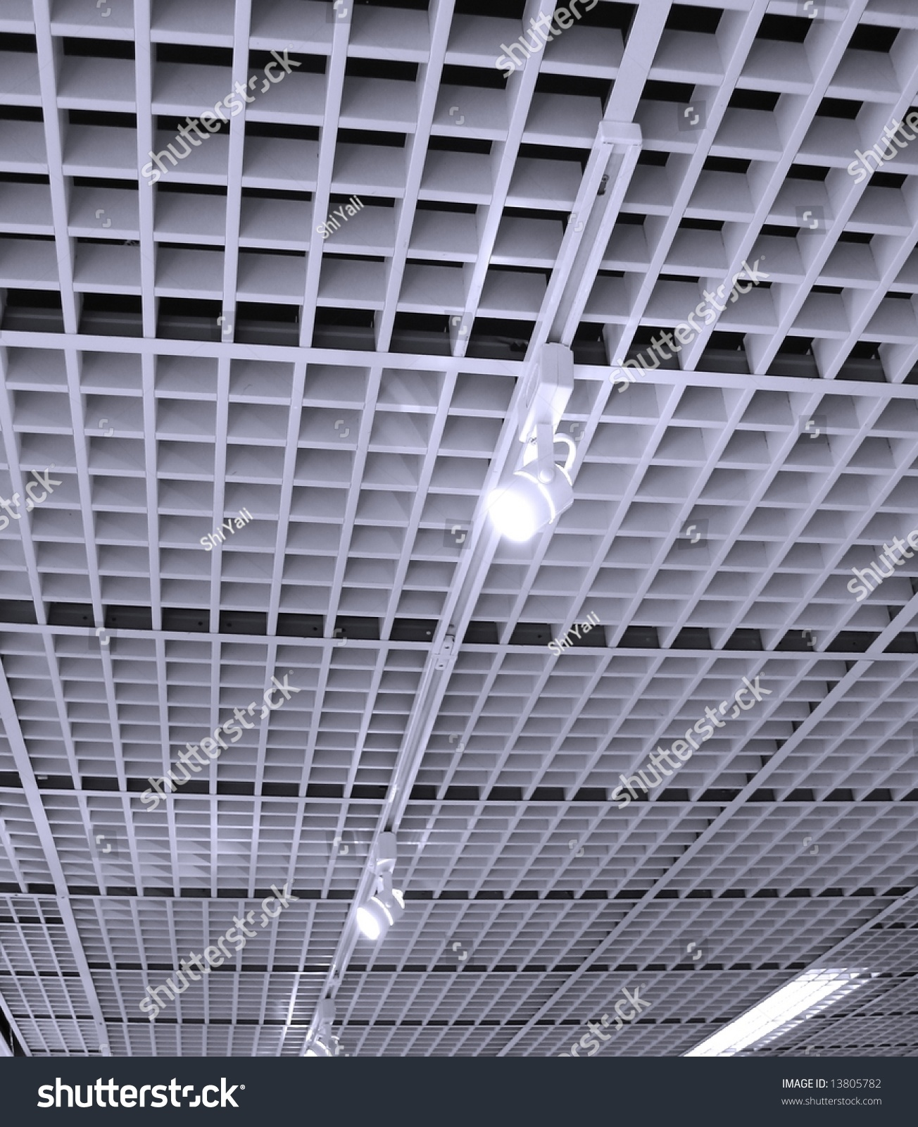 Office ceiling pattern made ceiling tiles stock photo 13805782 office ceiling pattern made up of ceiling tiles lights on rails dailygadgetfo Images