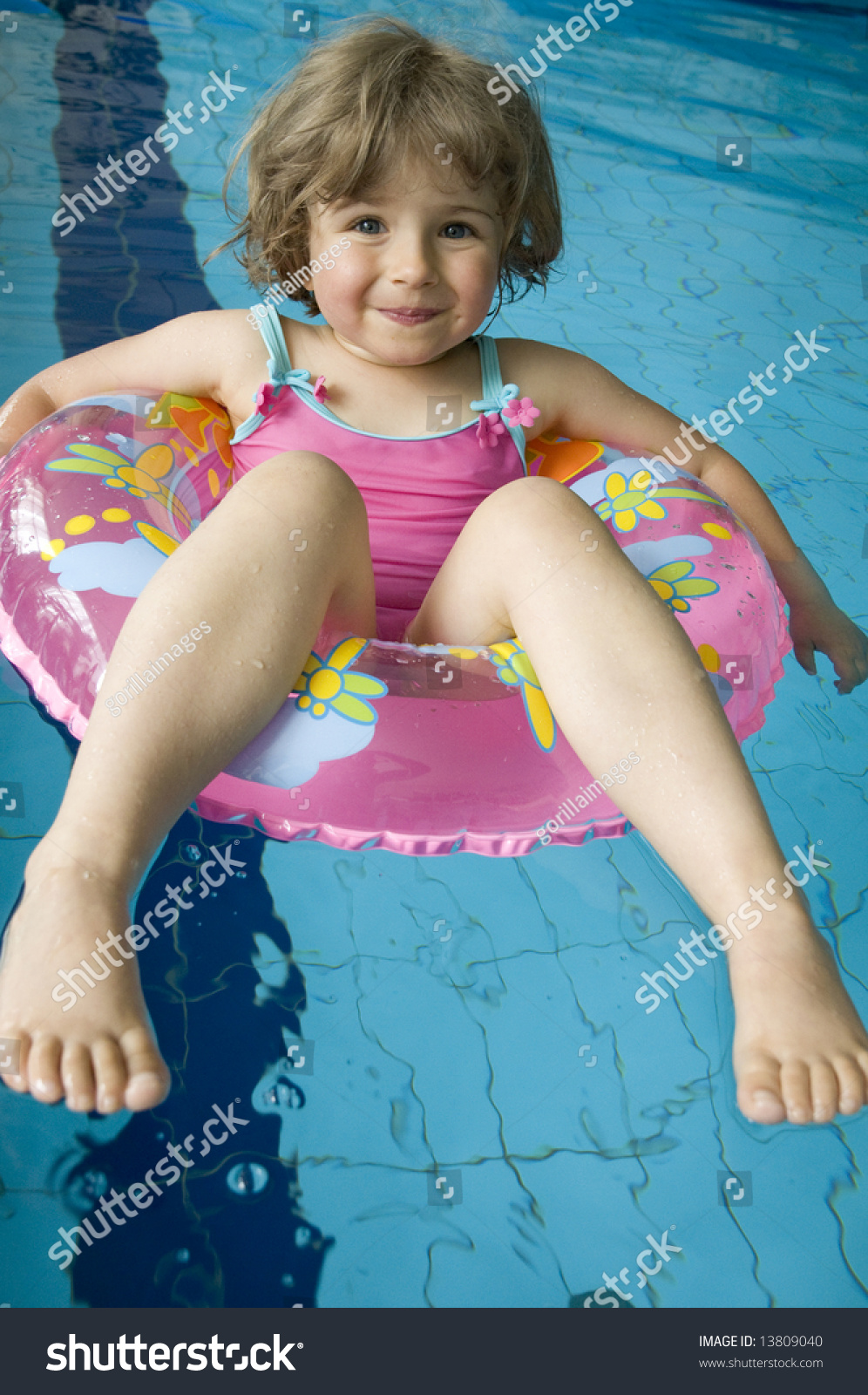 Little Girl Inner Tube Floating On Stock Photo 13809040