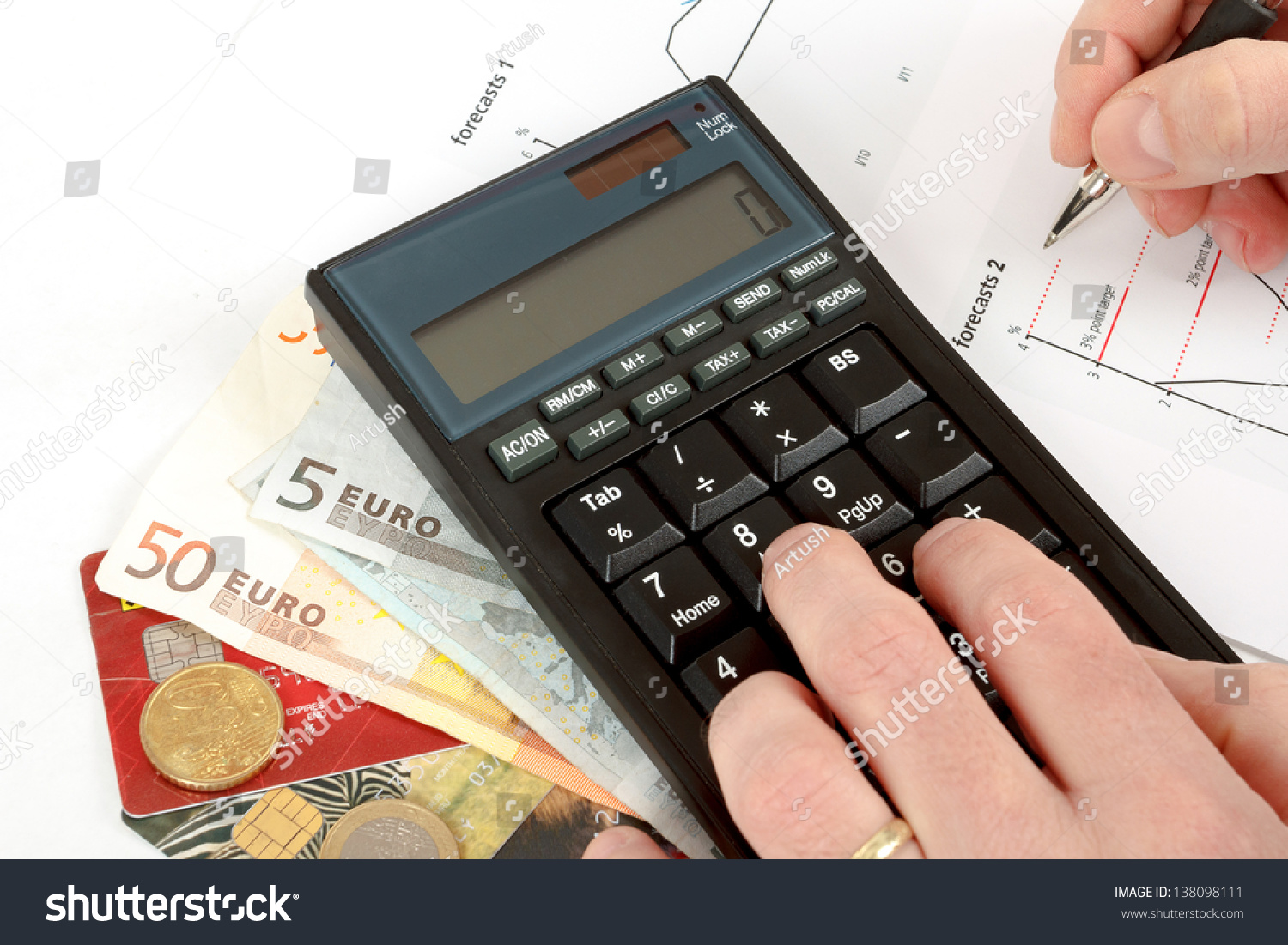 Calculator charts pen hand business cards stock photo royalty free calculator charts pen in hand business cards money workplace businessman colourmoves