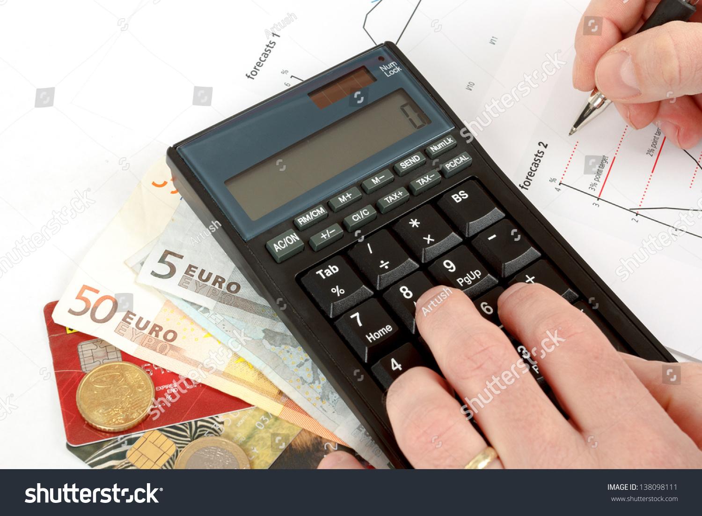 Calculator charts pen hand business cards stock photo 138098111 calculator charts pen in hand business cards money workplace businessman colourmoves
