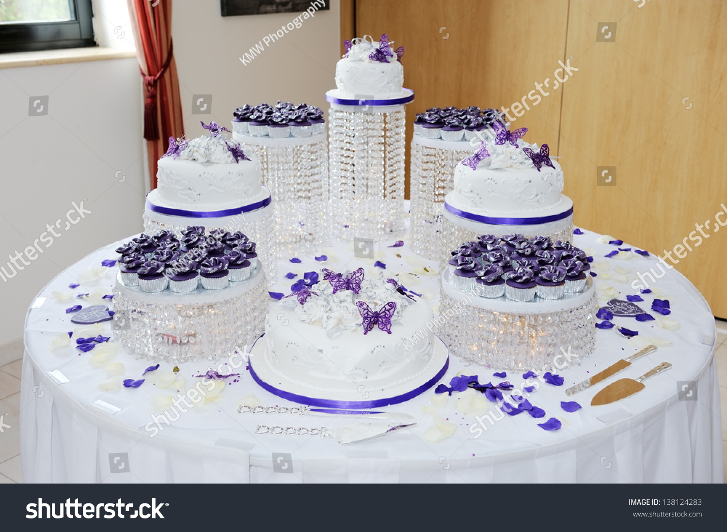 Huge Wedding White And Purple Wedding Cake At Reception