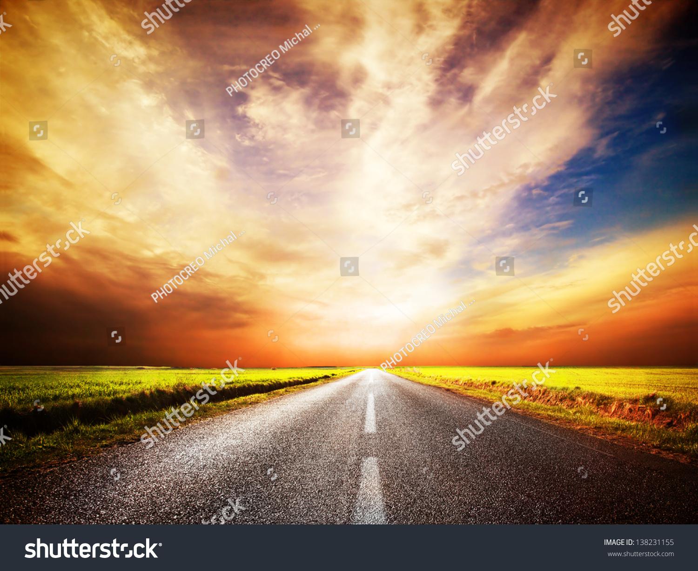 straight road sunset empty asphalt road sunset sky stock ima