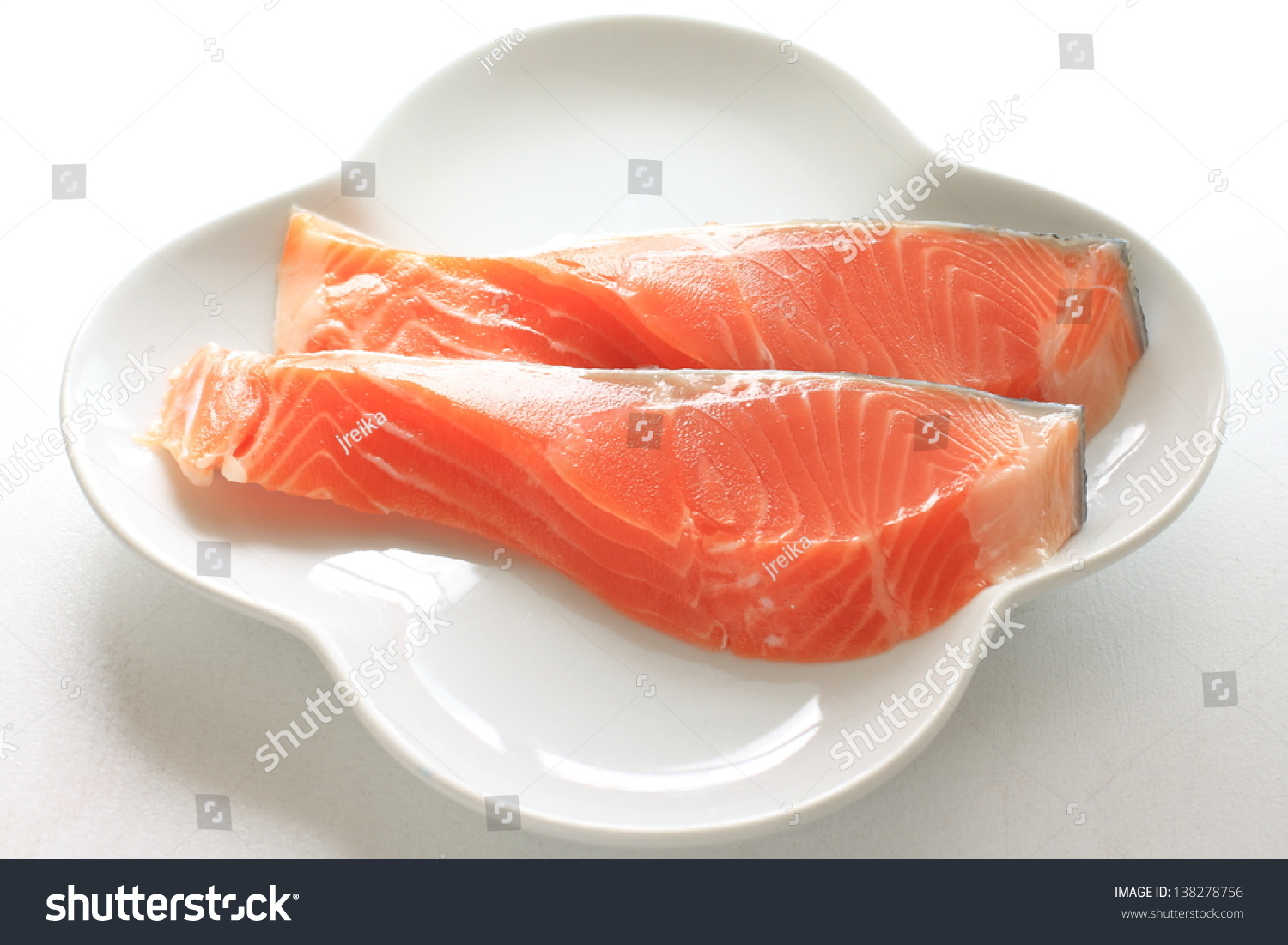 Freshness raw salmon fish on dish for gourmet ingredient for Raw fish dish